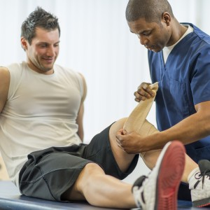 An athlete receiving rehibilitative care for a sports injury.